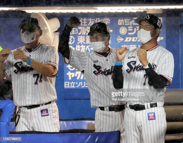 Yakult Swallows head coach Shingo Takatsu wearing a face mask celebrates as Norichika Aoki hits a two run home run 4th inning during the game between...