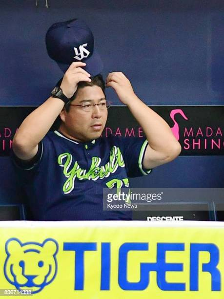 Yakult Swallows manager Mitsuru Manaka watches from the dugout a game against the Hanshin Tigers at Kyocera Dome in Osaka on Aug 5 2017 Manaka is set...