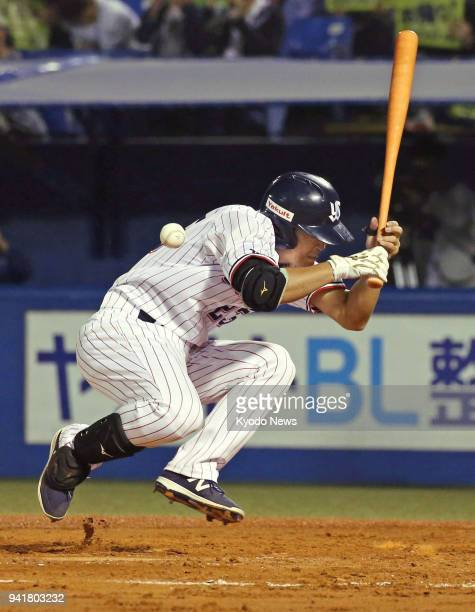 Yakult Swallows outfielder Norichika Aoki is hit by a pitch in the first inning of a game against the Hiroshima Carp in Tokyo on April 3 2018 ==Kyodo