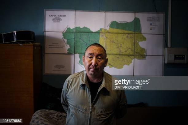 Yakutia's chief pilot observer of Aerial Forest Protection Service Svyatoslav Kolesov poses near the village of Byas-Kyuel, on July 27, 2021. -...