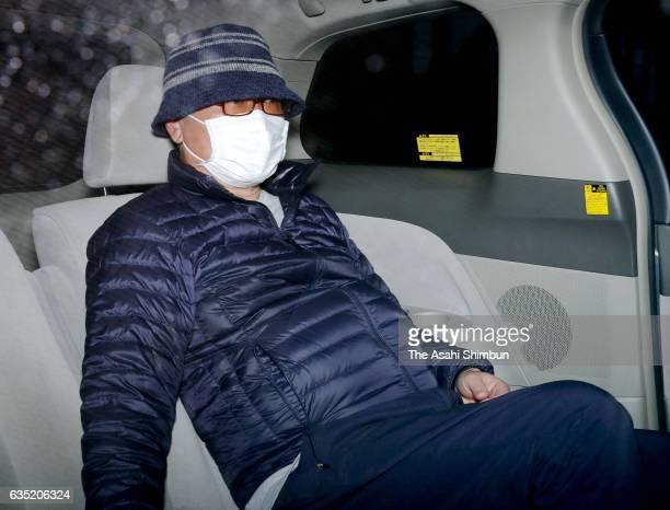 Yakuza leader Yoshiyuki Takayama leaves his home to voluntarily appear before prosecutors on February 14 2017 in Kyoto Japan The yakuza leader whose...