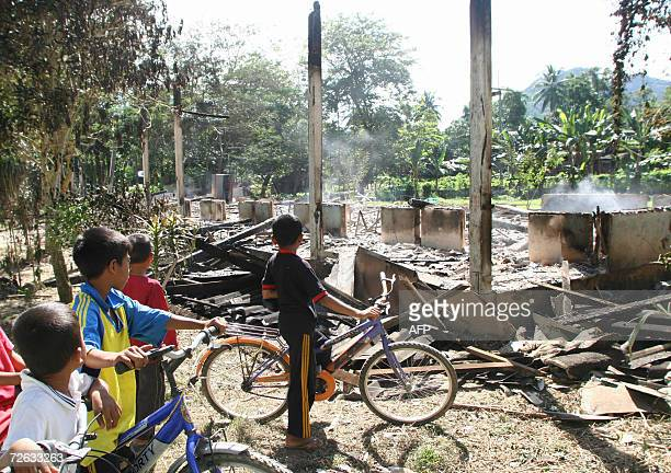 Thai Muslim children look at their damage classroom set on fire by Islamic militants in Yala province southern Thailand 23 November 2006 Suspected...