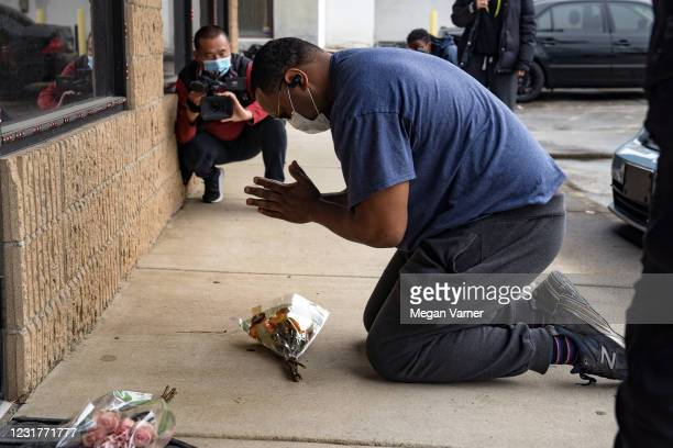 Yalaba Mendoza visits the site of two Atlanta spas to mourn the eight people killed in shootings at three Atlanta-area spas on March 17, 2021 in...