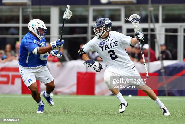 Yale Bulldogs attackman Ben Reeves and Duke Blue Devils defender JT GilesHarris during the NCAA Division I Men's Championship match between Duke Blue...