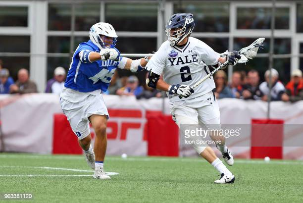 Yale Bulldogs attackman Ben Reeves defended by Duke Blue Devils defender Kevin McDonough during the NCAA Division I Men's Championship match between...