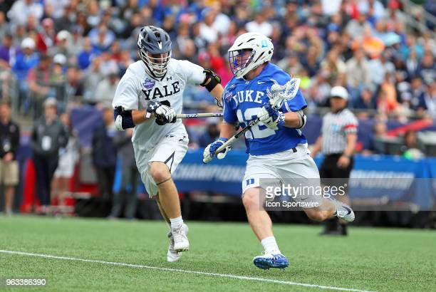 Yale Bulldogs attackman Lucas Cotler pursues Duke Blue Devils midfielder Kevin Quigley during the NCAA Division I Men's Championship match between...