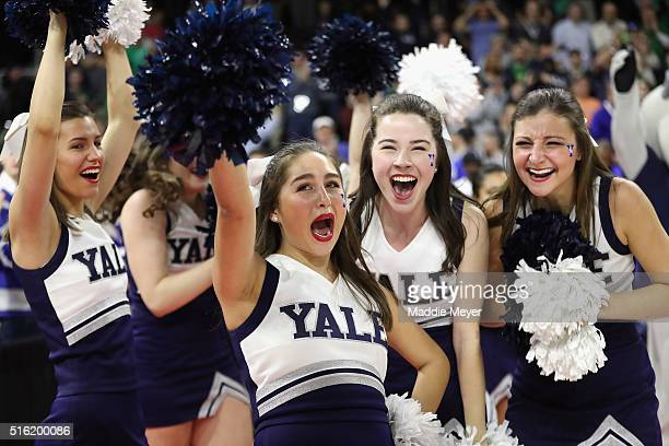 Yale Bulldogs cheerleaders celebrate after the Yale Bulldogs defeated the Baylor Bears 79-75 during the first round of the 2016 NCAA Men's Basketball...