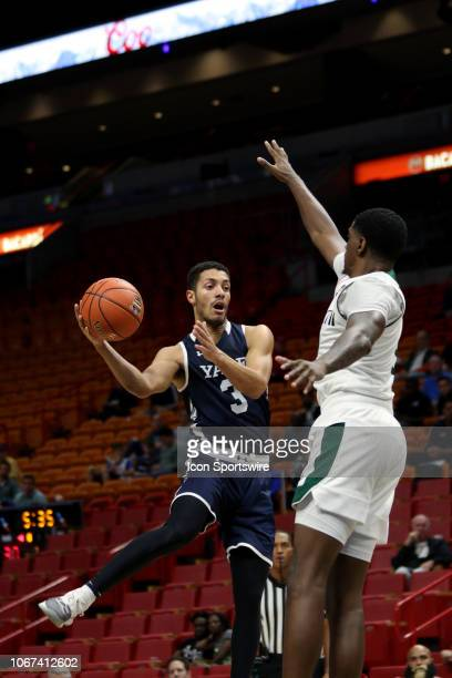 Yale Bulldogs guard Alex Copeland attempts to pass around Miami Hurricanes guard Anthony Lawrence II during the first half of the Air Force Reserve...