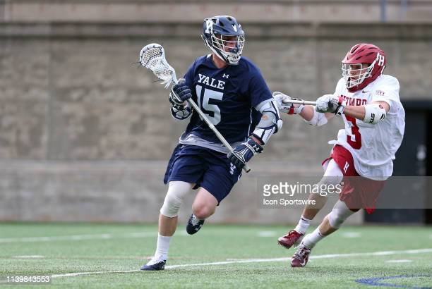 Yale Bulldogs Jackson Morrill and Harvard Crimson Frankie Tangredi in action during the college lacrosse match between Yale Bulldogs and Harvard...