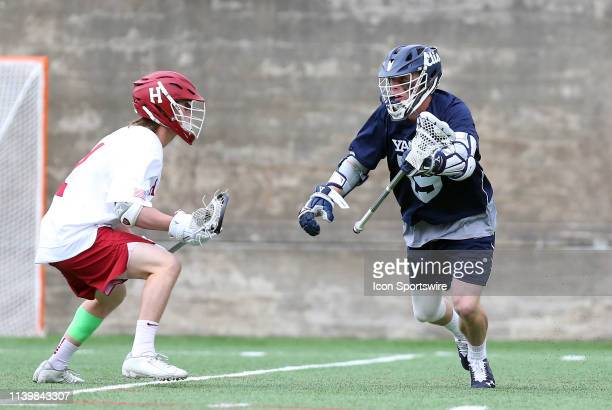 Yale Bulldogs Jackson Morrill and Harvard Crimson Jack Frisoli in action during the college lacrosse match between Yale Bulldogs and Harvard Crimson...