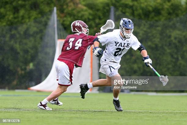 Yale Bulldogs midfielder Conor Mackie and UMass Minutemen faceoff Tom Meyers in action during the first round of the NCAA Division I Men's...