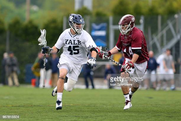 Yale Bulldogs midfielder Jason Alessi and UMass Minutemen midfielder Jeff Trainor during the first round of the NCAA Division I Men's Championship...