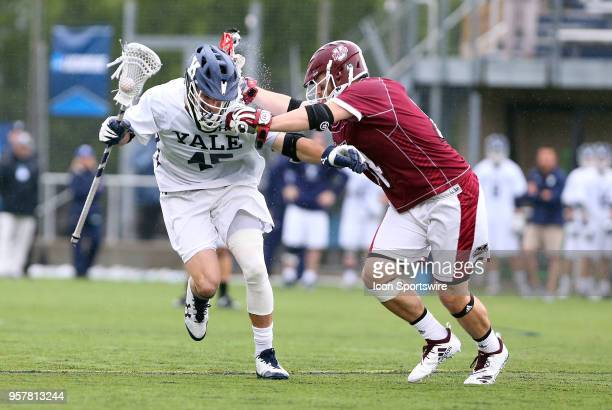 Yale Bulldogs midfielder Jason Alessi defended by UMass Minutemen midfielder Jeff Trainor during the first round of the NCAA Division I Men's...