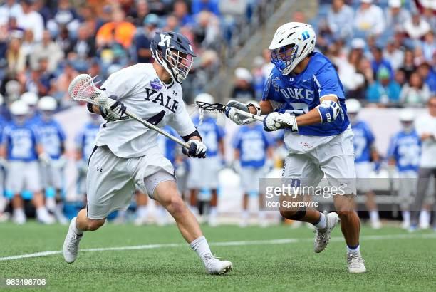 Yale Bulldogs midfielder John Daniggelis and Duke Blue Devils midfielder John Prendergast in action during the NCAA Division I Men's Championship...