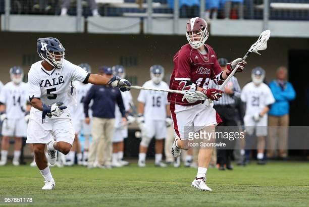 Yale Bulldogs midfielder Tyler Warner pursues UMass Minutemen midfielder Jeff Trainor during the first round of the NCAA Division I Men's...