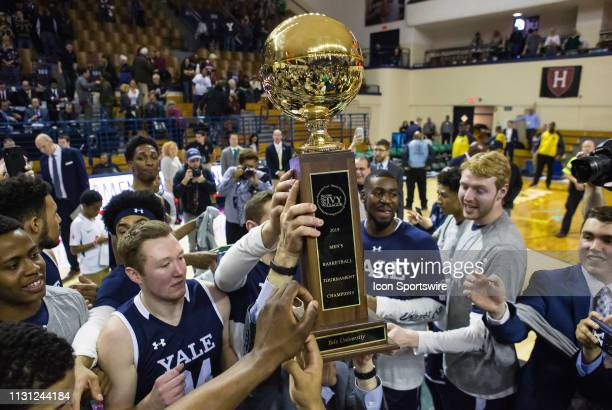 Yale Bulldogs players celebrate after defeating the Harvard Crimson and wining the Ivy League Championship on March 17 at John J Lee Amphitheater in...