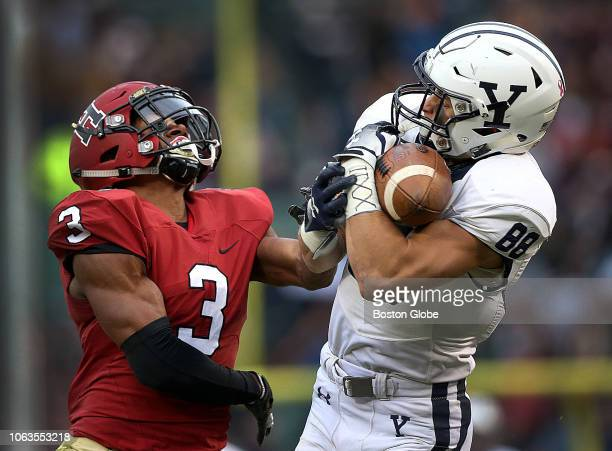 Yale Bulldogs wide receiver JP Shohfi makes the reception over Harvard Crimson defensive back Tyler Gray for a first down Yale scored a field goal on...