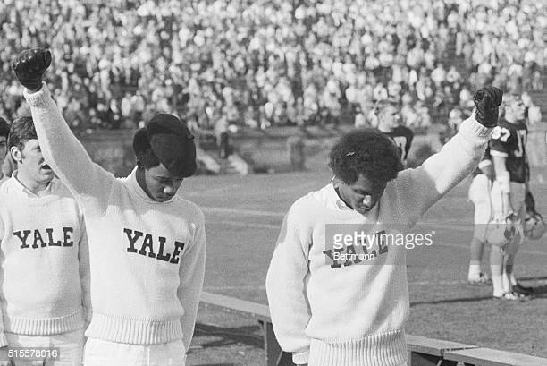 Yale cheerleaders Greg Parker and Bill Brown give the Black Power salute during the National Anthem starting the YaleDartmouth football game in the...