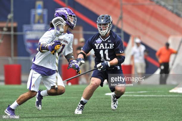 Yale Christopher Keating plays some tough defense against Albany Justin Reh . During theYale Bulldogs game against the Albany Great Danes at Gillette...