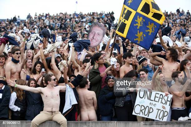 Yale fans cheer as they remove their clothes in the third quarter of a game against the Harvard Crimson at the Yale Bowl on November 18 2017 in New...