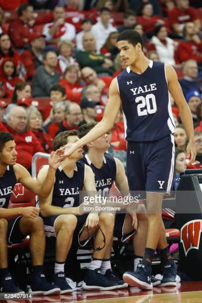 Yale Forward Paul Atkinson gets a hand shake after fouling out during an NCAA basketball game between the University of Wisconsin Badgers and the...