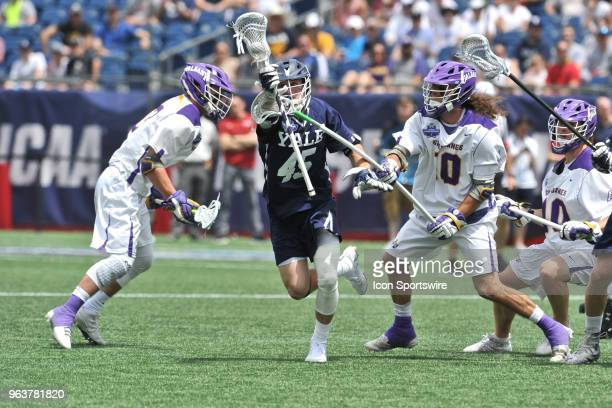 Yale Jason Alessi tries to get past Albany Troy Reh . During the Yale Bulldogs game against the Albany Great Danes at Gillette Stadium on May 26,...