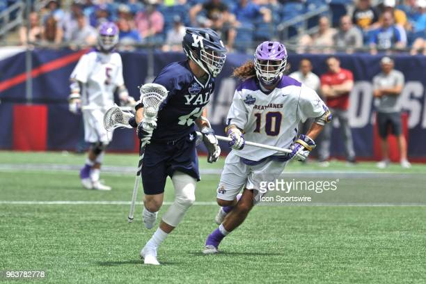 Yale Jason Alessi tries to keep the ball away from Albany Troy Reh . During theYale Bulldogs game against the Albany Great Danes at Gillette Stadium...