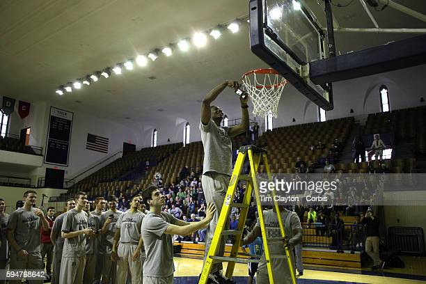 Yale player Justin Sears during the netcutting ceremony during the the Ivy League champion Yale men's basketball team Selection Sunday Watch Party at...