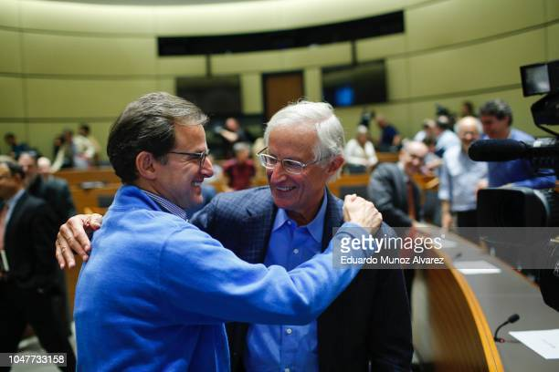 Yale Professor William Nordhaus is congratulated by attendees after speaking during a press conference after winning the 2018 Nobel Prize in Economic...