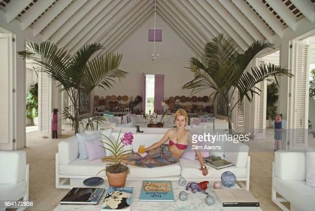 Yale student Edith Hansel lying on a sofa, Casa de Campo, Dominican Republic, circa 1990.