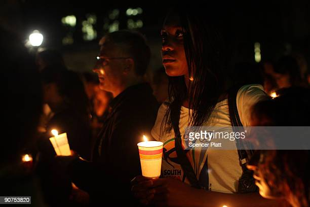 Yale students attend a candlelight vigil for fellow student Annie Le whose body was found behind a wall yesterday night in a laboratory building near...