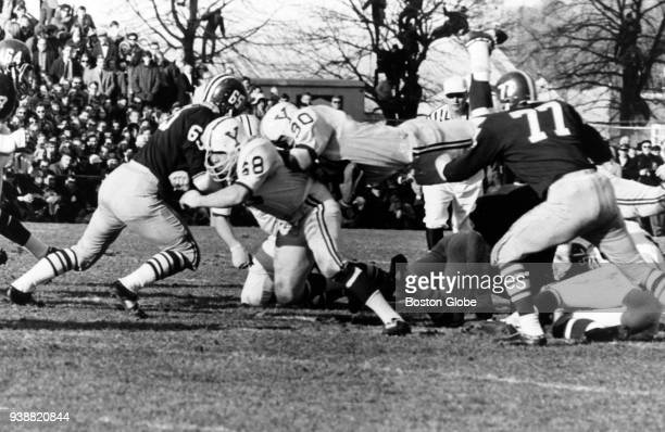 Yale University's Calvin Hull dives for a first down in the first quarter of The Game against Harvard University at Harvard Stadium in Boston on Nov...