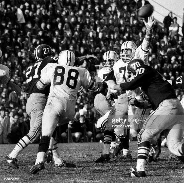 Yale University's Fran Gallagher tries to block a pass by Harvard University quarterback Frank Champi during The Game at Harvard Stadium in Boston on...