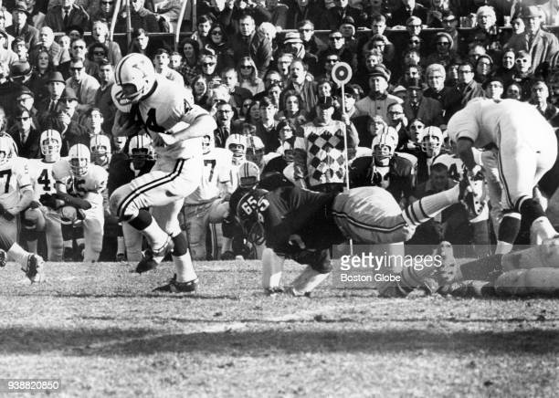 Yale University's Nick Davidson runs for a short gain in the second quarter of The Game against Harvard University at Harvard Stadium in Boston on...