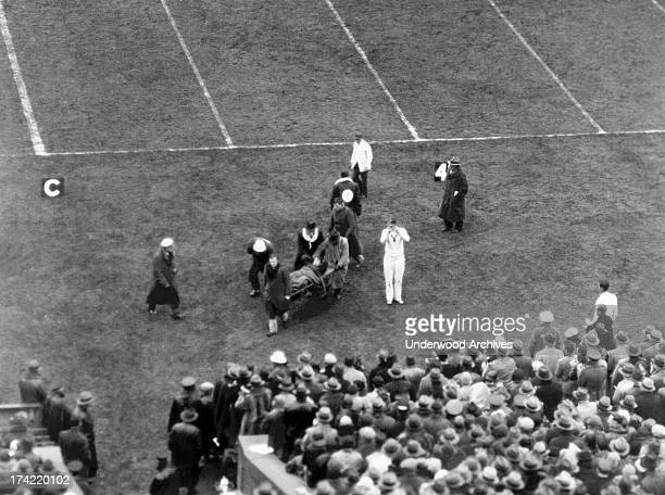 Yale's Albie Booth is carried off the field on a stretcher after being injured after intercepting a pass from the Army football team New Haven...