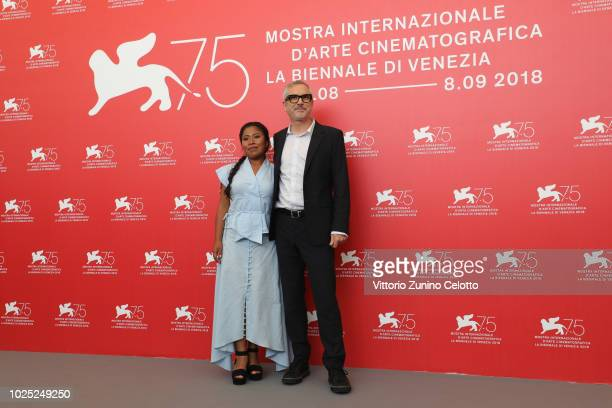 Yalitza Aparicio and Alfonso Cuaron attend 'Roma' photocall during the 75th Venice Film Festival at Sala Casino on August 30 2018 in Venice Italy