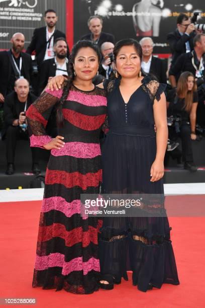 Yalitza Aparicio and Nancy García García walk the red carpet ahead of the 'Roma' screening during the 75th Venice Film Festival at Sala Grande on...