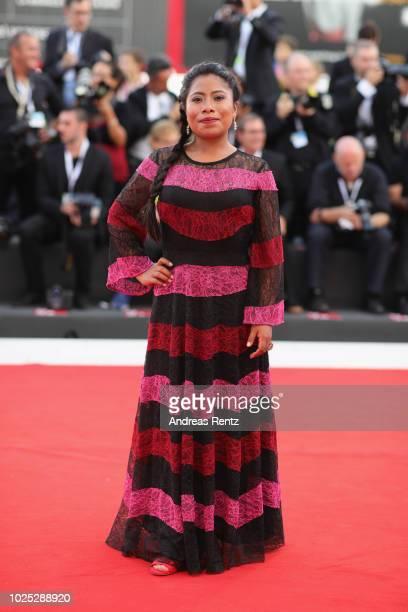 Yalitza Aparicio walks the red carpet ahead of the 'Roma' screening during the 75th Venice Film Festival at Sala Grande on August 30 2018 in Venice...