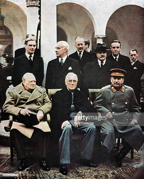 Yalta Conference of Allied leaders, World War II, 4-11 February 1945. Seated left to right: Churchill, Roosevelt and Stalin. Their respective foreign...