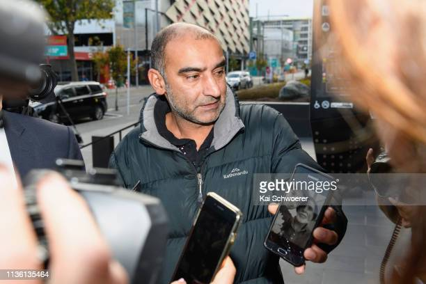 Yama Nabi shows a photo of his father Daoud Nabi who was killed at Al Noor mosque as he waits in front of Christchurch District Court where the...