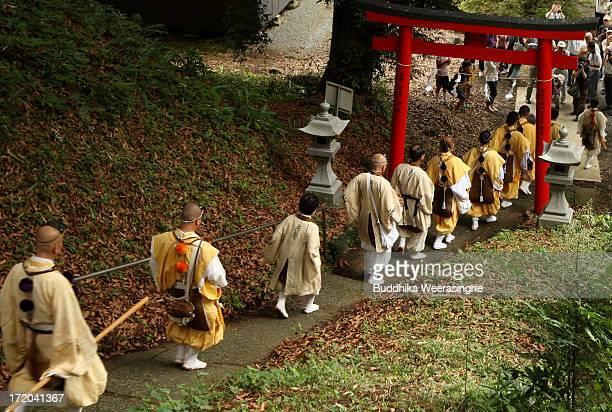 Yamabushi Japanese Buddhist monks climb the Mount Fuji to mark the annual ceremony of opening Mount Fuji for the public at Murayama Sengen Shrine on...