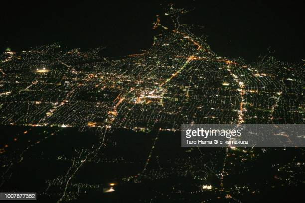 Yamagata city in Yamagata prefecture in Japan night time aerial view from airplane