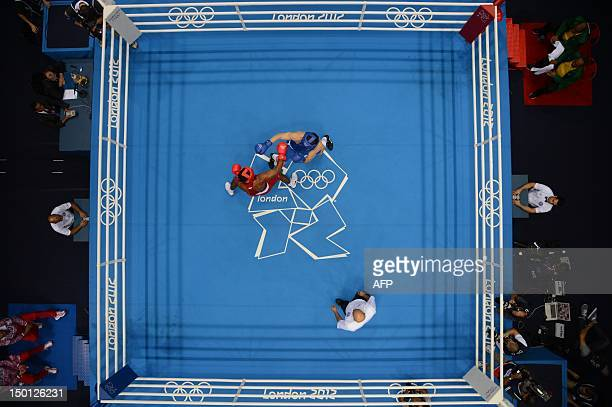 Yamaguchi Falcao Florentino of Brazil defends against Egor Mekhontcev of Russia during the men's Light Heavyweight boxing semifinals of the 2012...