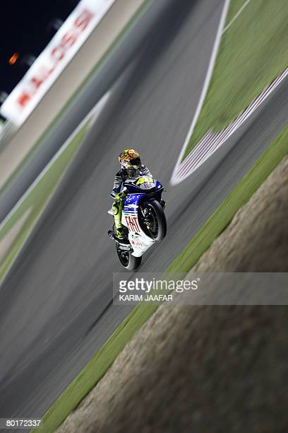 Yamaha ace Valentino Rossi of Italy races during the 2008 MotoGP free practice in Doha on March 8 2008 World champion Casey Stoner begins the defence...