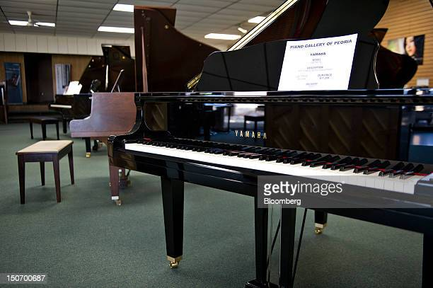 Yamaha Corp pianos sit on display in the showroom at the Piano Gallery of Peoria in Peoria Illinois US on Friday Aug 24 2012 Orders for US durable...