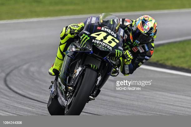 TOPSHOT Yamaha Factory Racing's Italian rider Valentino Rossi returns to the pit lane during the first day of the 2019 MotoGP preseason testing at...