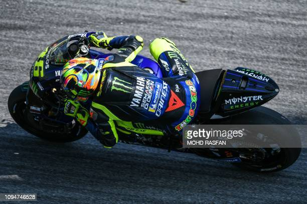 Yamaha Factory Racing's Italian rider Valentino Rossi steers his bike ater taking a corner during the second day of the 2019 MotoGP preseason testing...