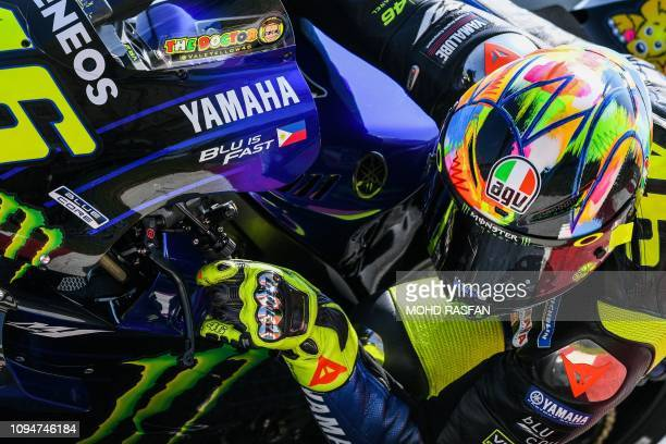 Yamaha Factory Racing's Italian rider Valentino Rossi takes a corner during the second day of the 2019 MotoGP preseason testing at the Sepang...