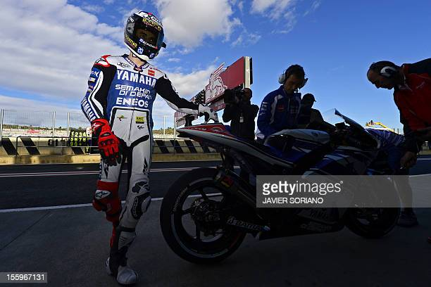 Yamaha Factory Racing's Spanish rider Jorge Lorenzo prepares to take part in a MotoGP free practice session of the Valencia Grand Prix at Ricardo...