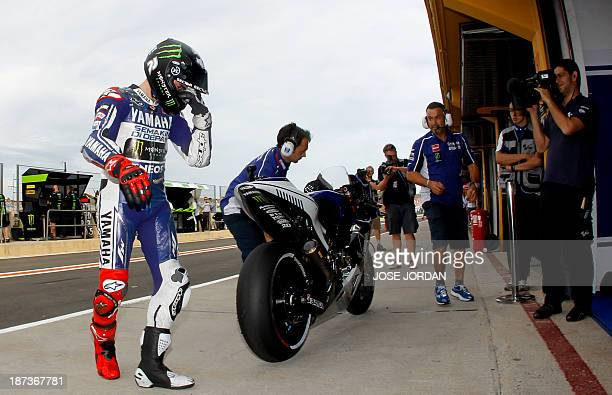 Yamaha Factory Racing's Spanish rider Jorge Lorenzo prepares to take part in the second Moto GP free practice of the Valencia Grand Prix at Ricardo...